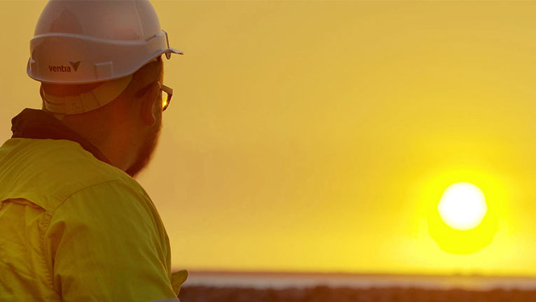 Ventia team member looking out into the sunset, Cox Peninsula
